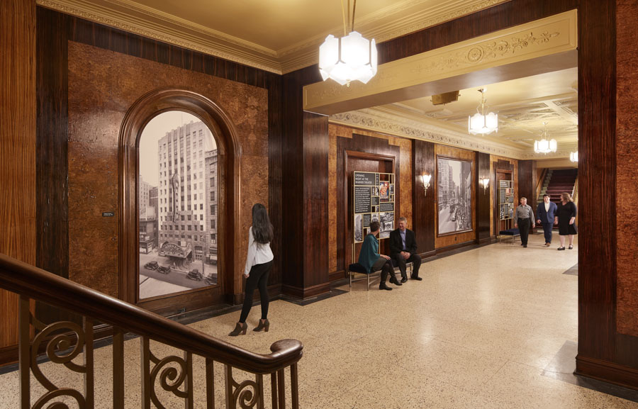 Hall spaces of the symphony hall with historic images on the wall of Milwaukee.