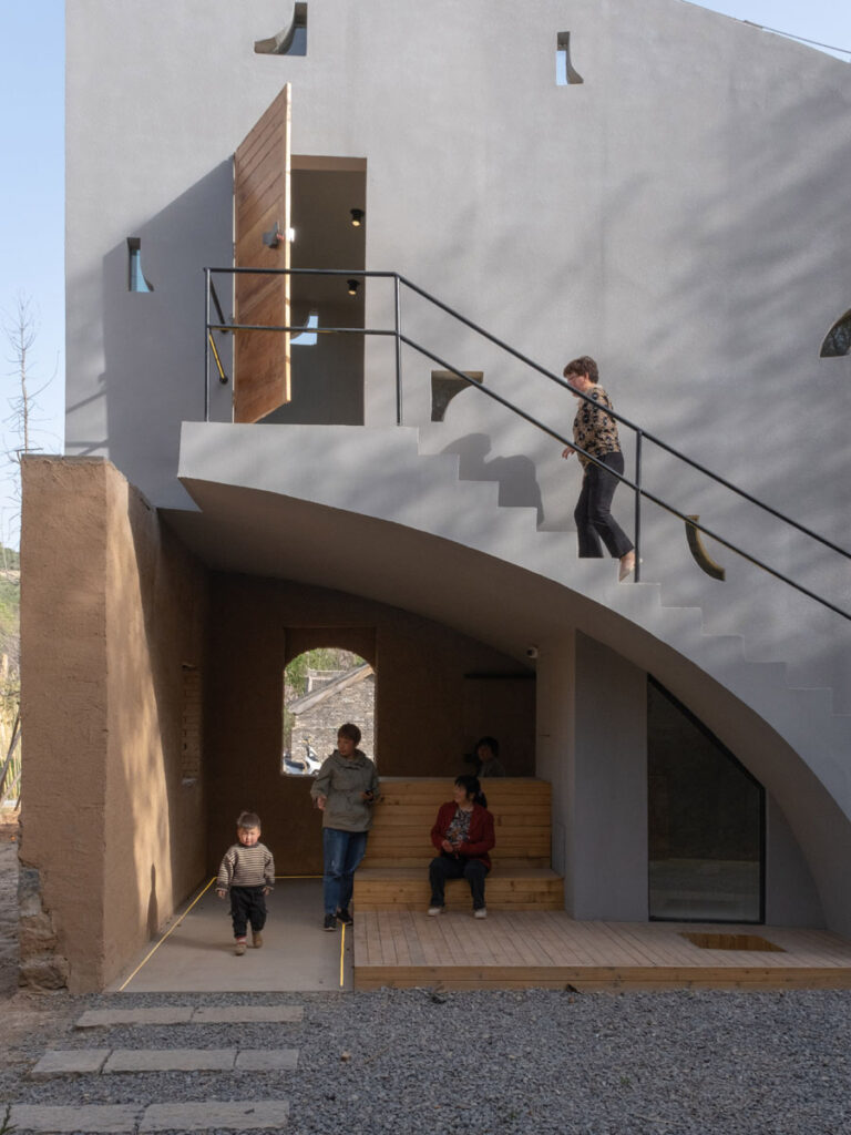 exterior elevation showing staircase and library patrons