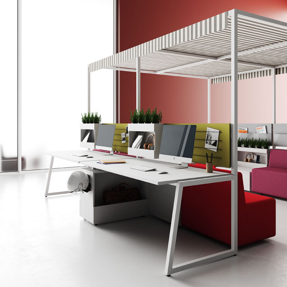 A modular workspace with couches, desks, and a cabana-like ceiling.