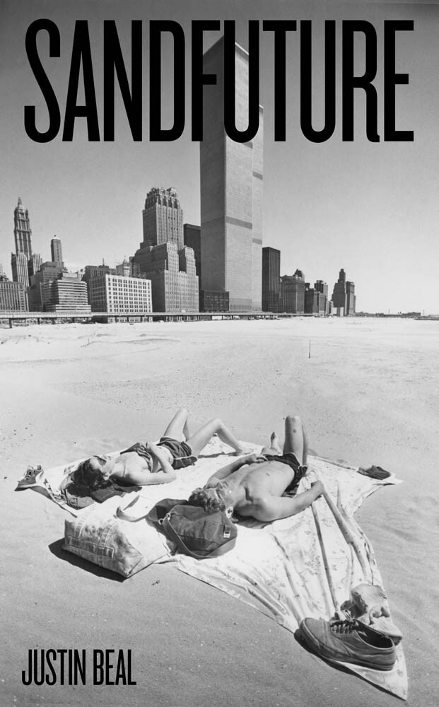 The cover of Sandfuture, showing a couple lying on a beach below the world trade center.