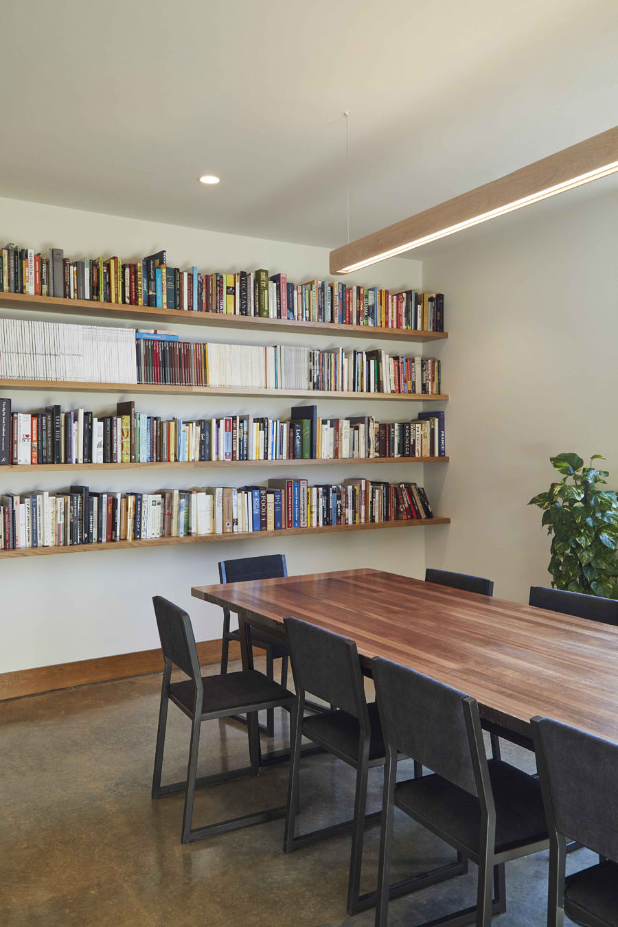 interior dining area with bookshelves lining walls